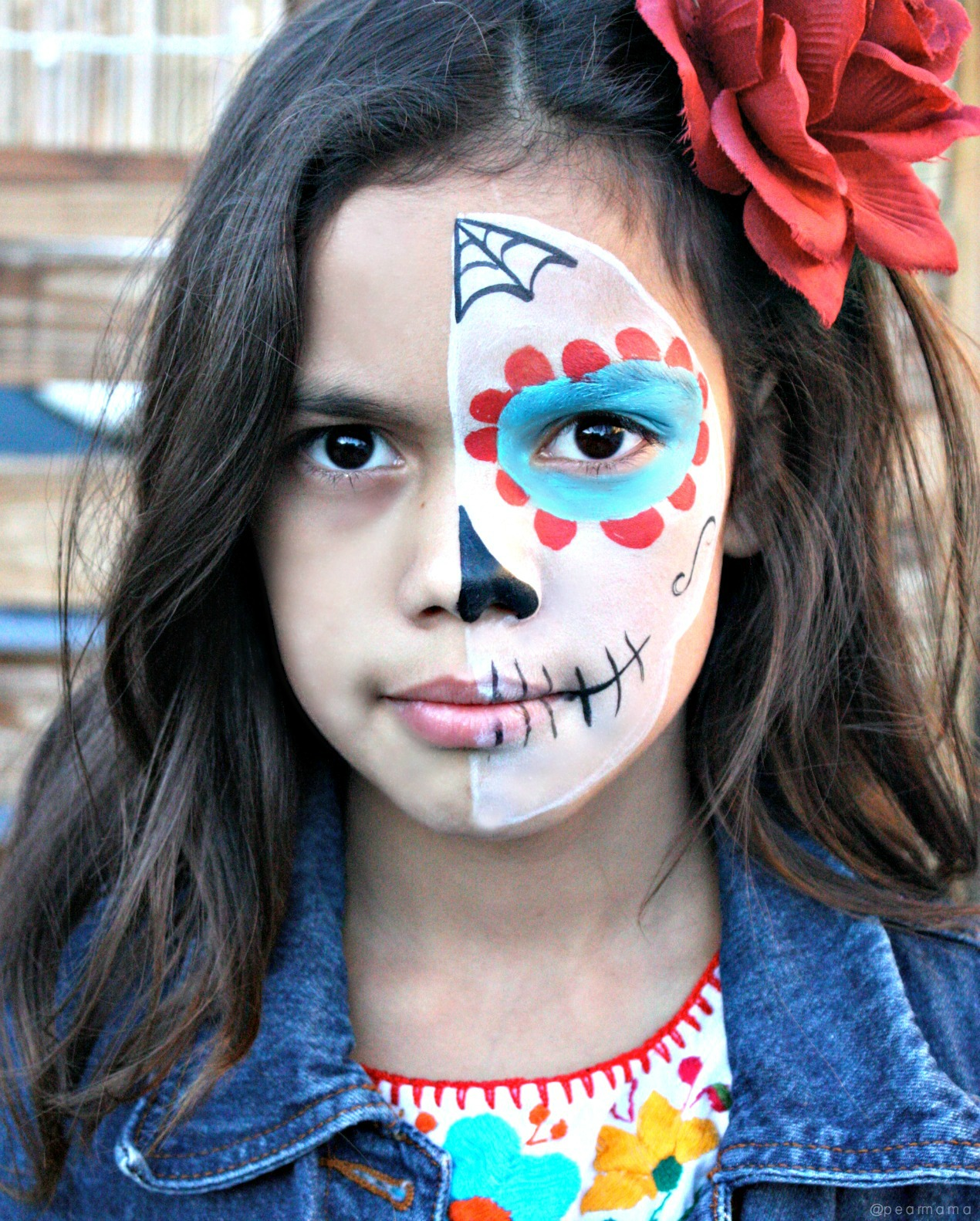 Watch this YouTube video and learn how to paint the perfect sugar skull makeup on your child to celebrate Day of the Dead.