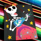 Using your favorite book for inspiration, make this calavera-inspired paper collage with your kids to celebrate the Mexican tradition of Dia de los Muertos.