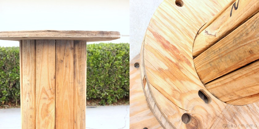 Make your own side table by repurposing a wooden cable spool.