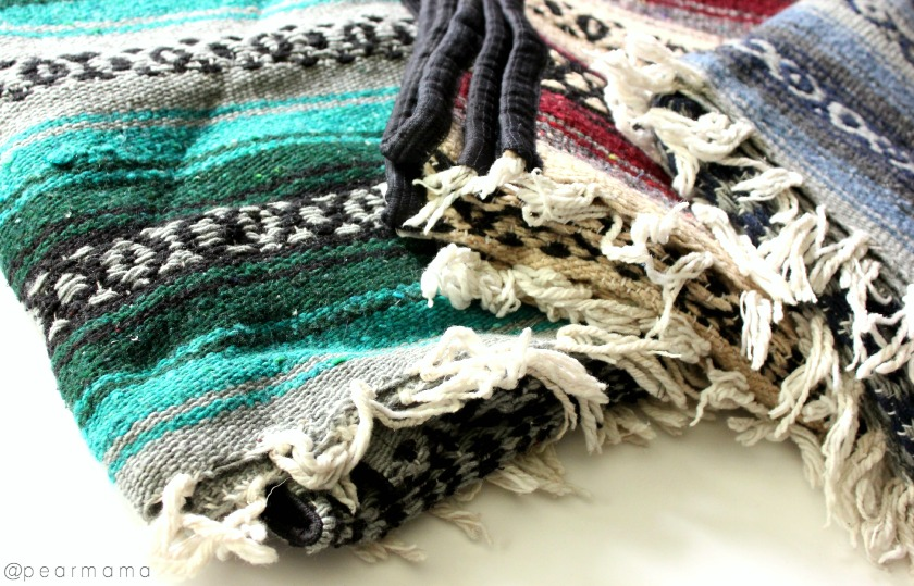 Use Mexican fabric to sew into pillows for your living space.