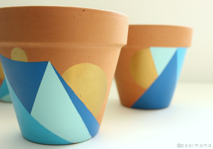 Paint geometric designs on your terracotta pots.