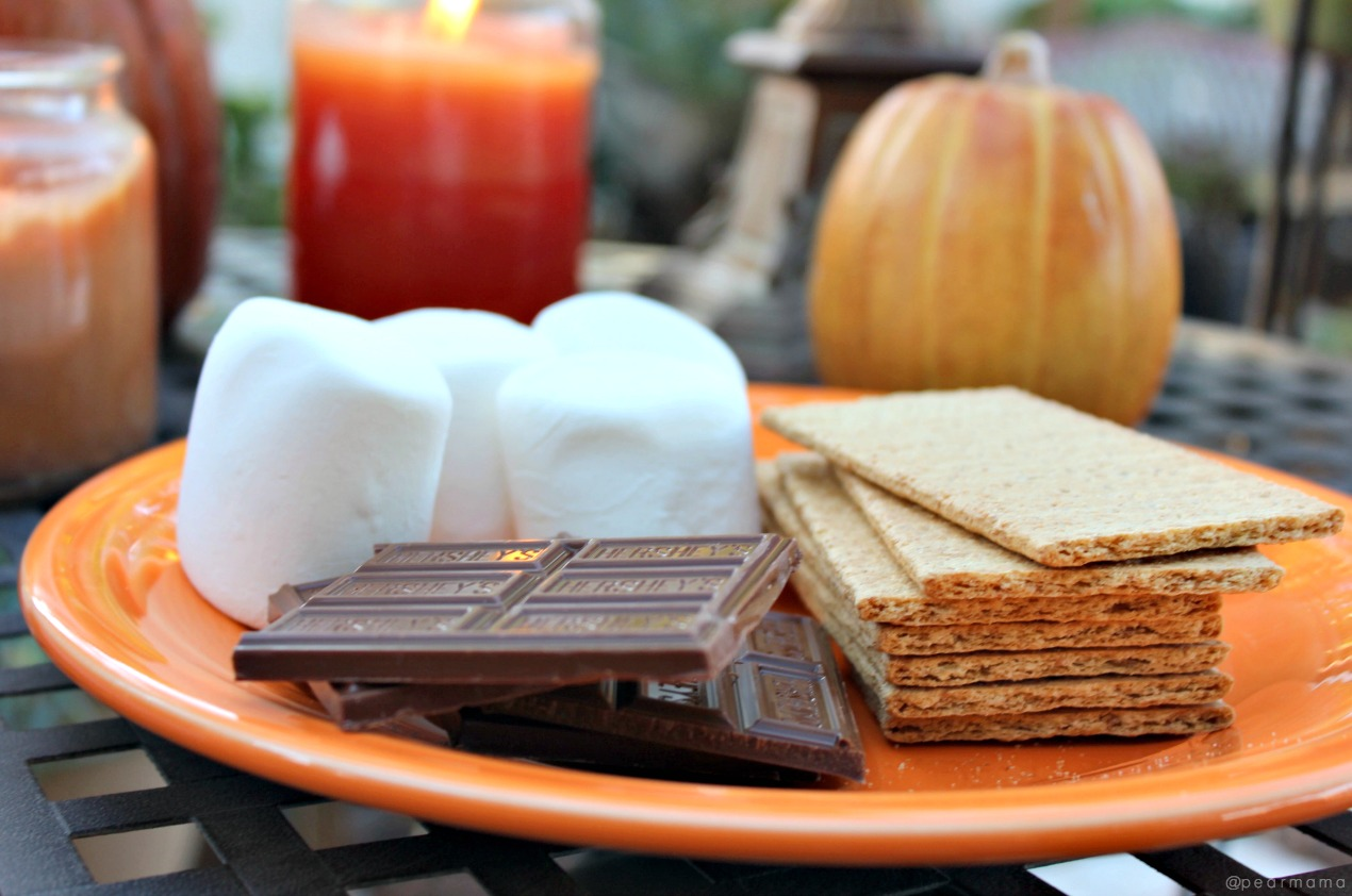 Everything you need to create a cozy spot around the fire pit for family Halloween hangs: candles, cozy fire + S'mores. Let the ghost stories begin!